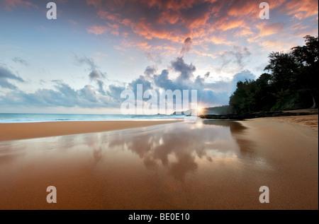 Sunrise at low tide at Secret Beach. Kauai, Hawaii. - Stock Photo