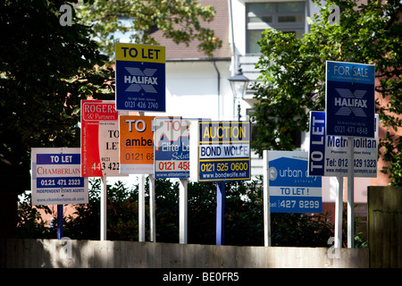 A row of for sale, to let and auction property signs in Birmingham, england, UK - Stock Photo