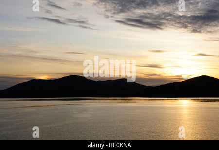 Sunset at the entrance of the Geirangerfjord, Norway, Scandinavia, Northern Europe, Europe - Stock Photo