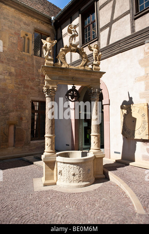 Old fountain in front of the Museum Unterlinden, Rue d'Unterlinden, Colmar, Alsace, France, Europe - Stock Photo