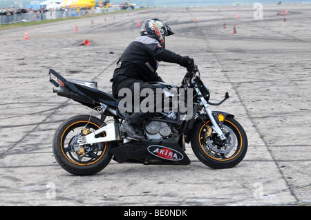 Streetbike freestyle stunt riders show in Warsaw, Poland - Stock Photo