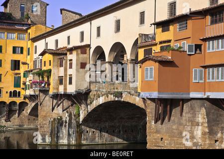 Tuscany Florence 14th Century Ponte Vecchio bridge across River Arno showing backs of goldsmiths workshops - Stock Photo