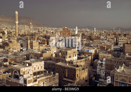 Minarets and traditional tower houses on the skyline of the old city of Sana'a, Yemen. - Stock Photo
