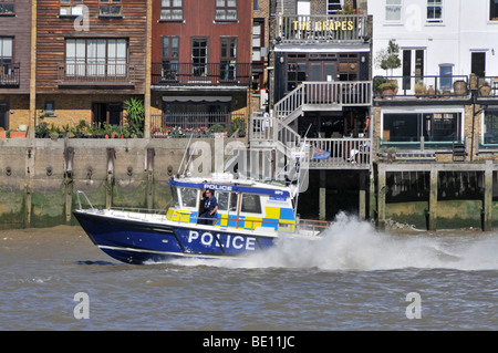 Police patrol boat at speed on River Thames - Stock Photo