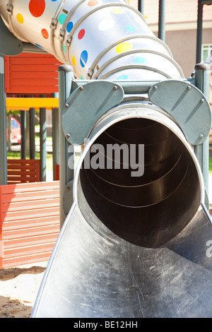 Jungle gym tube in children playground - Stock Photo