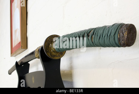 Japanese single edged sword - katana in a kake kept in its scabbard (or saya) at the shomen, or front wall of the - Stock Photo