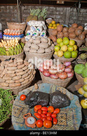 Fresh fruits and vegetables are on sale at the 'Les Cocotiers' market in Cotonou, Benin. - Stock Photo
