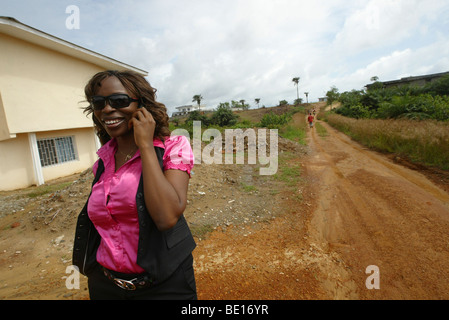 Monrovia, Liberia - September, 20 , 2008: A lady(Famatta Sanoe) on the Mobile phone in a community in monrovia. - Stock Photo