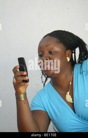 Monrovia, Liberia - September, 20 , 2008: A woman(Vicky Jah) dialing her phone in monrovia. Photo by. Ahmed Jallanzo. - Stock Photo