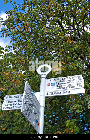 thames cycle route and thames path sign beside the river thames at teddington lock, middlesex,  england - Stock Photo