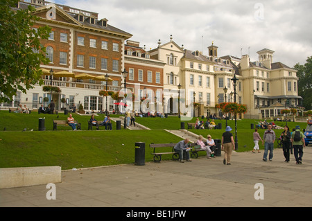 People Enjoying A Summers Afternoon On A Grass Terrace Overlooking The River Thames Richmond Surrey England - Stock Photo