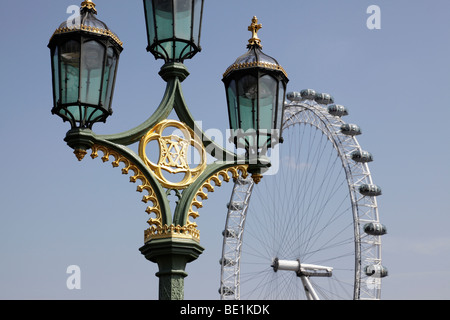 top of a lamp post on westminster bridge with the millennium wheel in the background london uk - Stock Photo