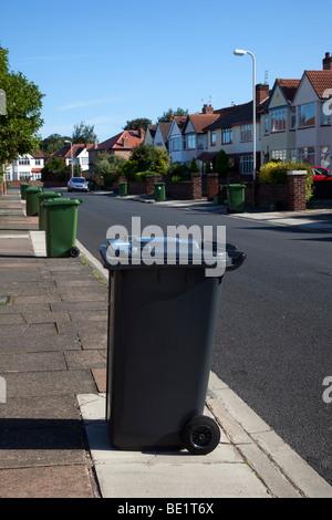 """Bin blighted"" streets_Non- Recyclable Waste Wheelie bins roadside at  Highfield Road, Southport, Merseyside UK - Stock Photo"