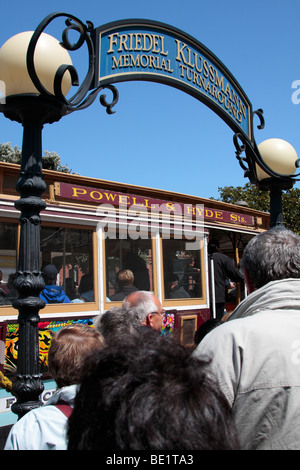 Queuing for the cablecar at the end of the line at the Friedel Klussmann turnaround in San Francisco California - Stock Photo