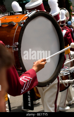 Drummer playing in a marching band in Bristol Rhode Island Fourth of July parade - Stock Photo