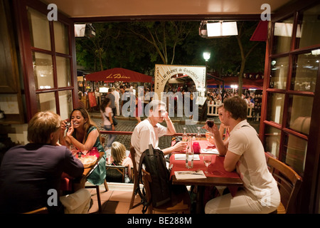 people eating in a cafe restaurant interior in the evening, Montmartre, Paris, France, Europe - Stock Photo