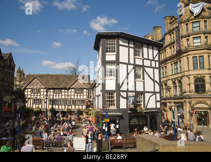 Manchester England UK Customers of the Old Wellington Inn and Sinclairs Oyster Bar sitting outside in the sun in - Stock Photo