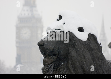 trafalgar square lion and big ben in snow, London february 2009 - Stock Photo
