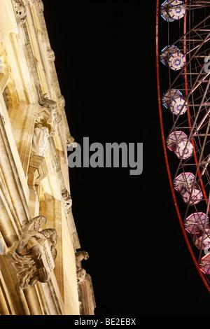 Illuminated building and 'Big Wheel' at night, 'St Giles' Funfair, Oxford, England, UK - Stock Photo