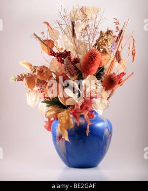 Dried flowers in a blue vase. - Stock Photo