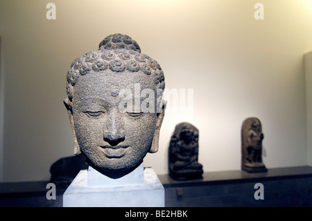 Head of a Buddha on display in the musée Guimet, a museum dedicated to Asian arts in Paris, France. - Stock Photo