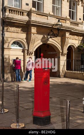 UK, England, Staffordshire, Stafford, Market Square, hexagonal Victorian Pillar box near entrance to Bank Passage - Stock Photo