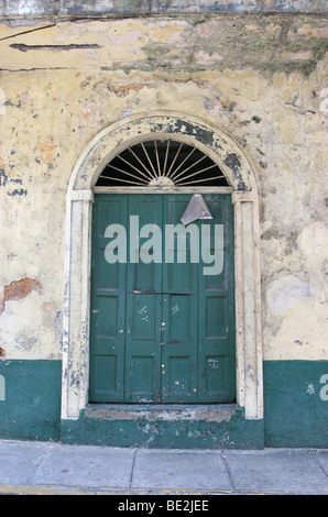 Old green door at an abandoned building of Panama City's Casco Antiguo - Stock Photo