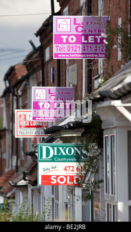 House for sale signs and to let signs on terraced homes in the Selly Oak area of Birmingham, England, UK - Stock Photo