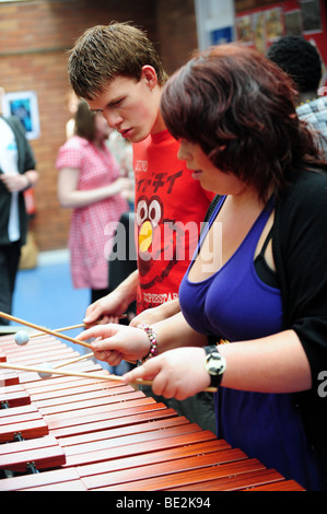 Musicians practice at a sixth form further education college - Stock Photo