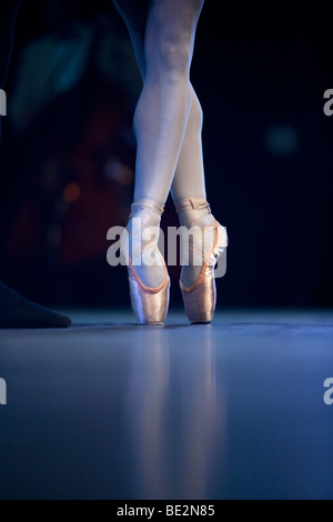 A ballet dancer's feet on stage - Stock Photo