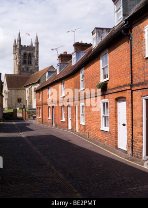 Row of Victorian terraced houses / cottages in front of St Andrew's Parish Church. Farnham. Surrey. UK. - Stock Photo