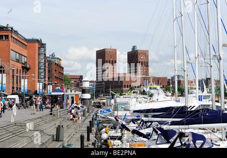 City Hall and Aker Brygge shopping street, Oslo, Norway, Scandinavia, Northern Europe - Stock Photo