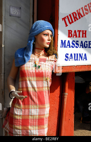 Mannequin wearing a headscarf at the entrance to a Turkish Bath with massage and sauna in the Sultanahmet district, - Stock Photo