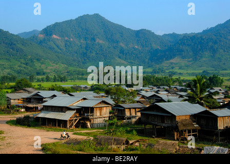 Village with huts made of wood and corrugated iron roofs in a valley, Ou Tai, Gnot Ou district, Yot Ou, Phongsali, - Stock Photo