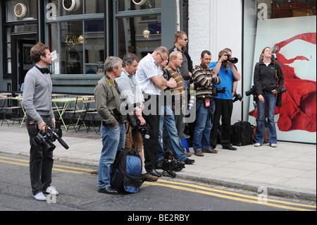 London's paparazzi wait for a celebrity. - Stock Photo