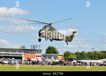 American transport helicopter Sikorsky S-58C during a flight demonstration, Europe's largest meeting of vintage - Stock Photo