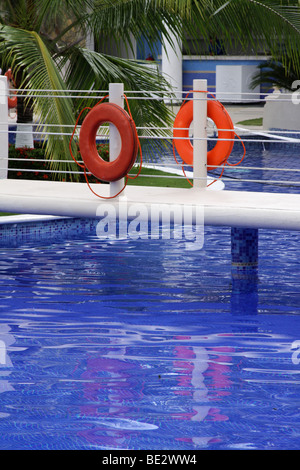 Life savers at a pool with blue water in Panama City. - Stock Photo