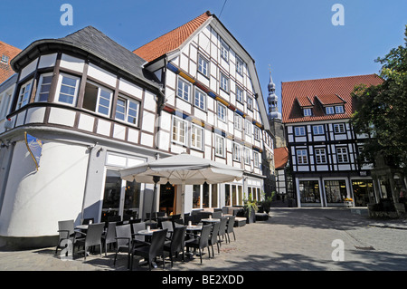 Sidewalk cafe, half-timbered houses, church tower, square, historic town centre, Soest, North Rhine-Westphalia, - Stock Photo