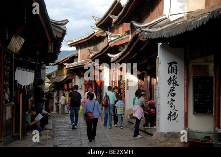 People, tourists, street in the old town with Chinese characters, Lijiang, UNESCO World Heritage Site, Yunnan Province, - Stock Photo