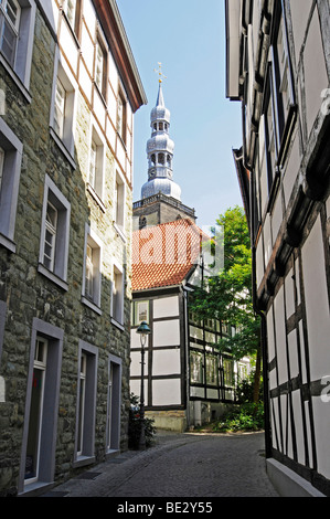 Narrow street, half-timbered houses, church tower, historic town centre, Soest, North Rhine-Westphalia, Germany, - Stock Photo