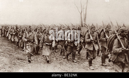 German and Austrian soldiers marching shoulder to shoulder against the Russians during World War I. - Stock Photo