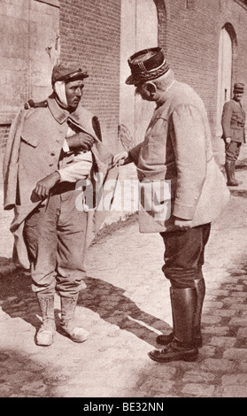General Joffre sympathizing with one of his wounded soldiers during World War I. - Stock Photo