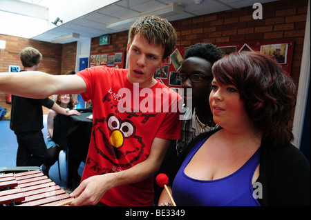 Students in music class at sixth form further education college - Stock Photo