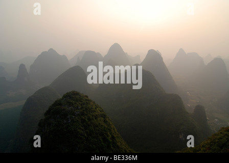 View from a hot-air balloon over the rocky karst landscape near Yangshuo in the evening haze, Guilin, Guangxi, China, - Stock Photo