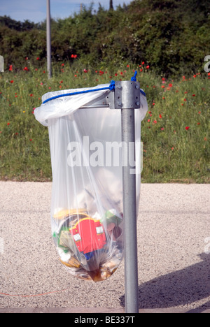 close up of street bin bag with contents - Stock Photo