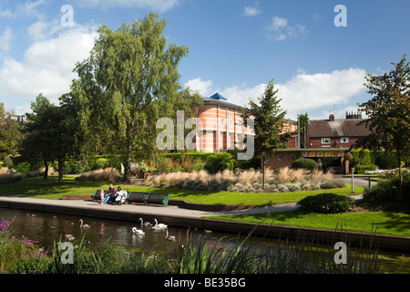 UK, England, Staffordshire, Stafford, Victoria Park, young family feeding ducks and swans on River Sow - Stock Photo