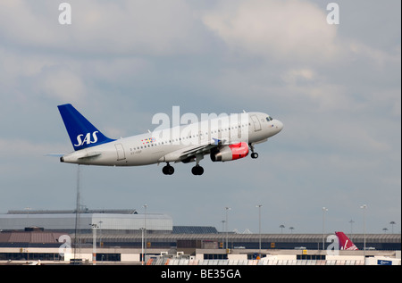 SAS aircraft taking off from Manchester Airport (Ringway Airport) - Stock Photo