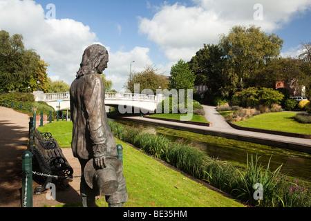 UK, England, Staffordshire, Stafford, Victoria Park, Izaac Walton statue on banks of River Sow - Stock Photo
