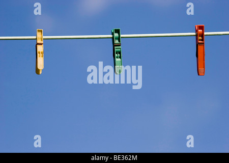 pegs on a washing line - Stock Photo
