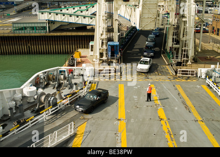 Cars being loaded onto a car ferry at Dover in the South East of England - Stock Photo